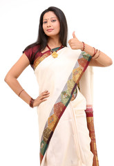 Woman in white sari posing challenge action