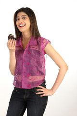 Slim Teenage girl eating a piece of chocolate cake