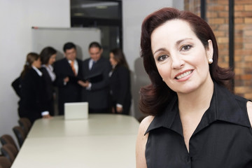 Portrait of businesswoman with his teamwork
