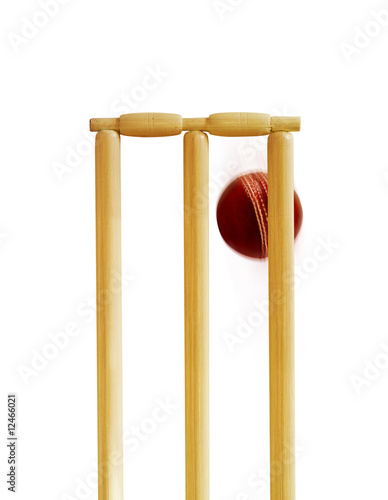 cricket bat and ball and stumps. Cricket ball hitting stumps