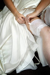 Bride fastening her stocking