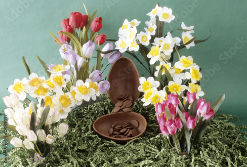 Chocolate easter egg halved with flowers and contents.