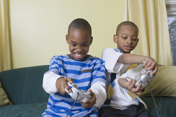 Two boys playing electronic games