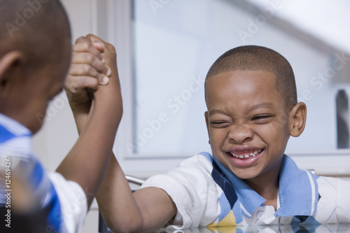 Two young boys playing arm wrestling