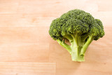 Broccoli on wooden work surface