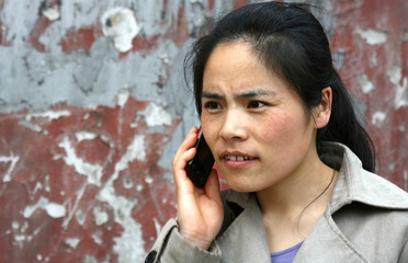 nervous and upset woman on cell phone