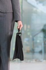 business woman carrying briefacse.