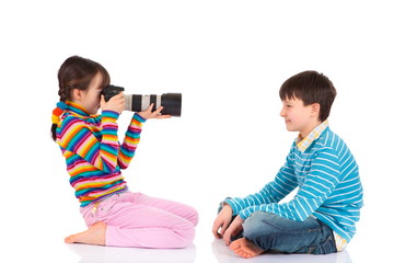 Girl photographing brother