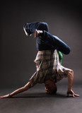 breakdancer standing in complicated pose poster
