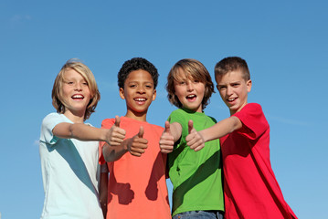 happy group of diverse children thumbs up