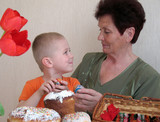 grandson and grandmother prepare for Easter poster