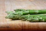 Asparagus Spears On Cutting Board poster