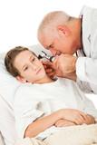 Pediatrician Examines Patient poster