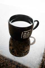 coffee cup with Chinese double happiness symbol