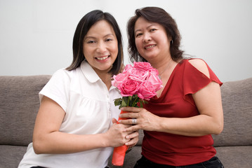 Asian females posing with flowers