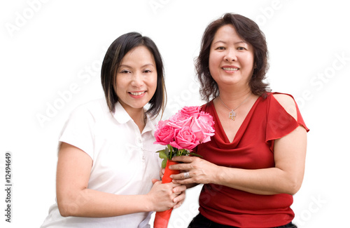 Asia lady posing with mum and flowers
