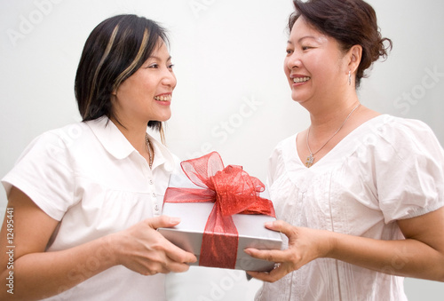 Gift giving between two asian ladies