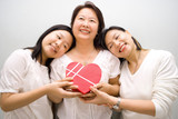 Mum receiving gift and love from daughters