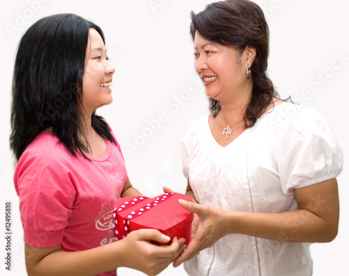 Lady receiving gift from daughter