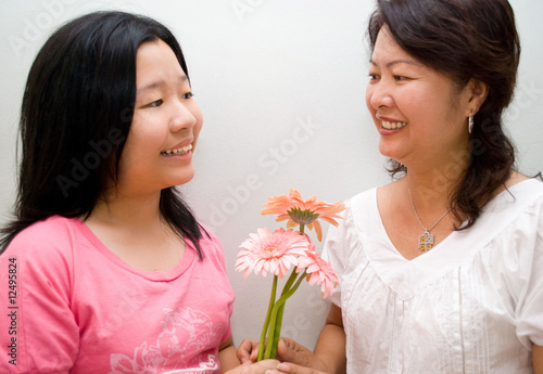 Mother receiving flowers