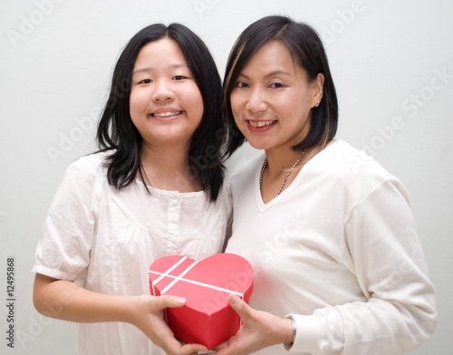 Two female posing with love gift box