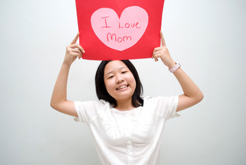 Asian girl with i love mum message