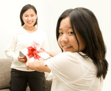 Asian girl giving gift