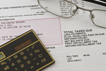 property tax statement with glasses and calculator
