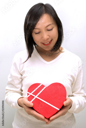 Asian lady posing with gift box