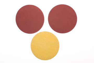three disks of sandpaper