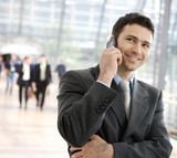 Fototapety Businessman calling on phone