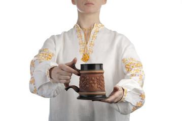 Woman's hand holding beer mug