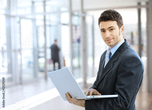 Businessman using laptop - 12529269