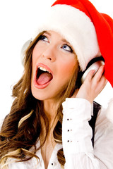 sidepose of christmas woman listening music