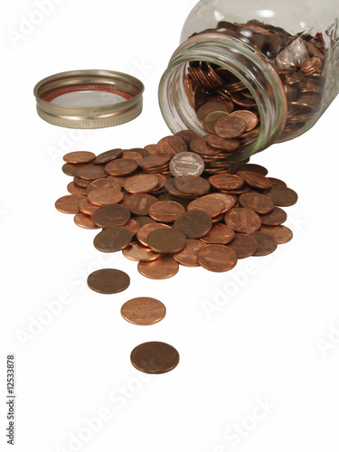 Pennies Spilling out of Mason Jar