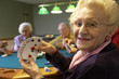 Senior adults playing bridge - 12536444