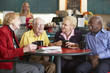 Senior adults having morning tea together - 12536679
