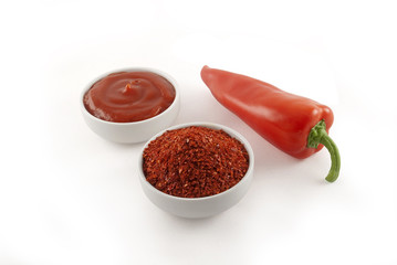 Ketchup, red pepper, ground red pepper. Clipping path. Isolated.
