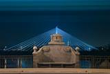 Fototapety stone bench on  illuminated bridge by night in Warsaw