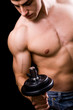 Bodybuilder in action - muscular powerful man lifting weights
