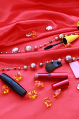 many cosmetics on red background