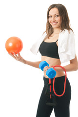 Woman with ball, dumbbell, expander, terry towel, isolated