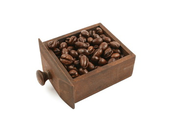 coffee beans in wooden drawer close up in studio