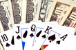Different banknotes and poker cards