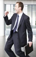 A successful businessman making triumphal gesture