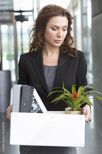 A redundant businesswoman taking her belongings home