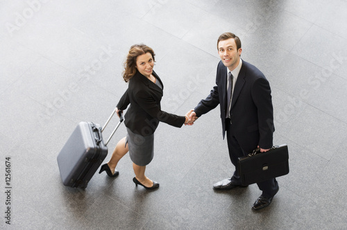 A businessman and woman shaking hands
