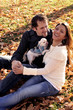 Smiling Attractive Interracial Couple Outdoors With Dog