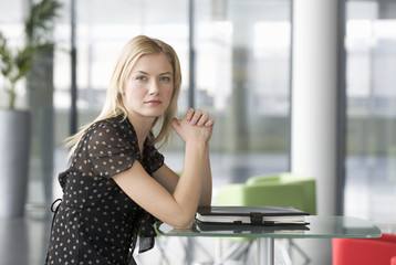 A businesswoman sitting in a modern office