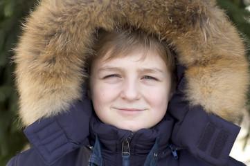 Portrait of the boy in a hood